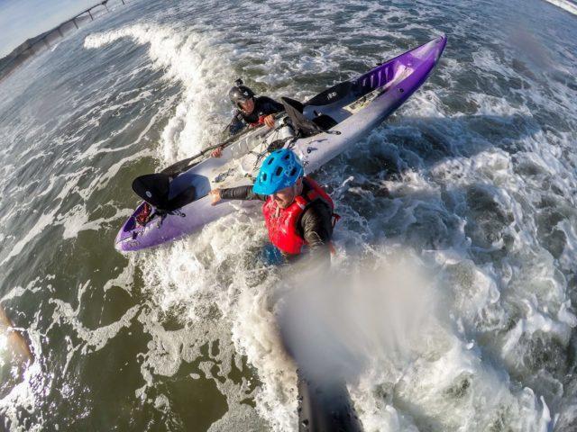 Tandem kayak surfing