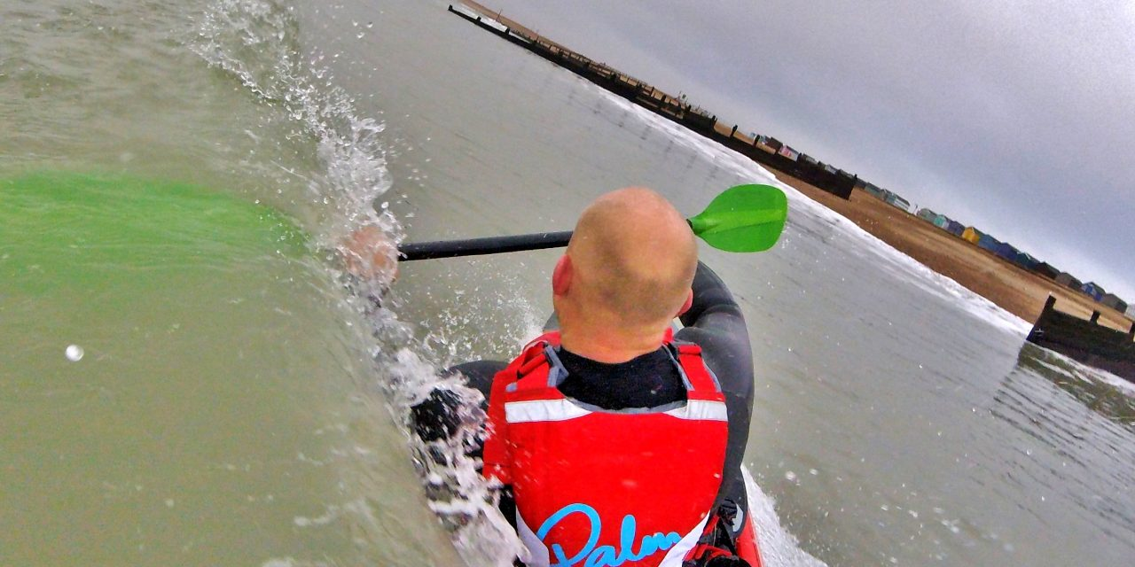 Getting back aboard your sit on top kayak after a wipe-out in waves