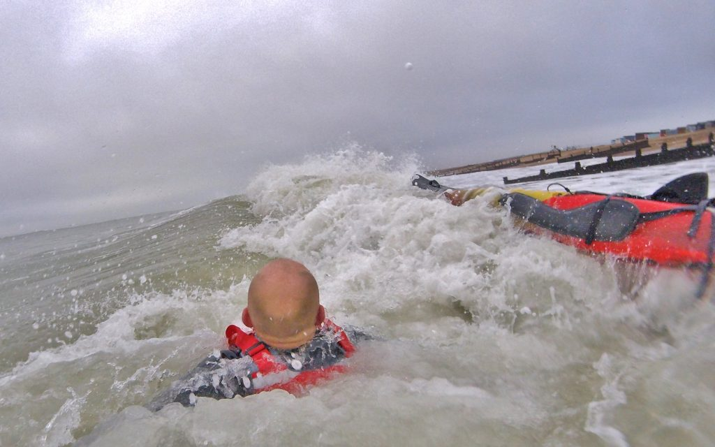 Getting back aboard your sit on top kayak after a wipe-out in waves 1