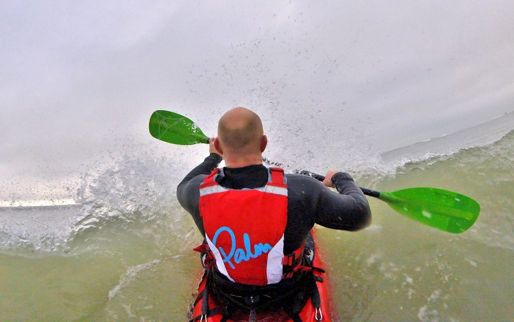 Getting back aboard your sit on top kayak after a wipe-out in waves 10