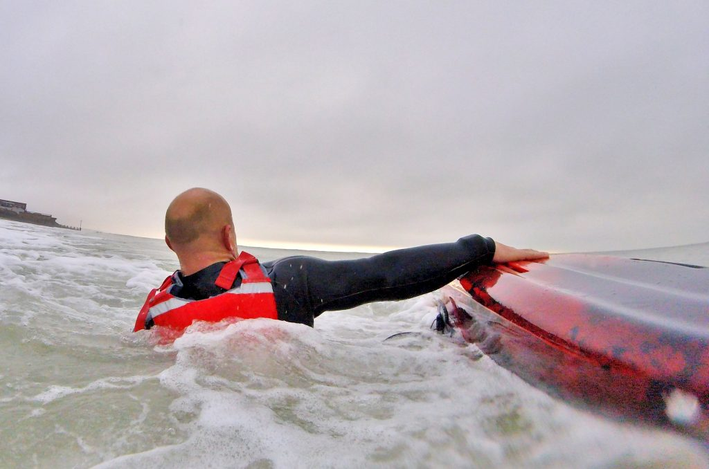 Getting back aboard your sit on top kayak after a wipe-out in waves 2
