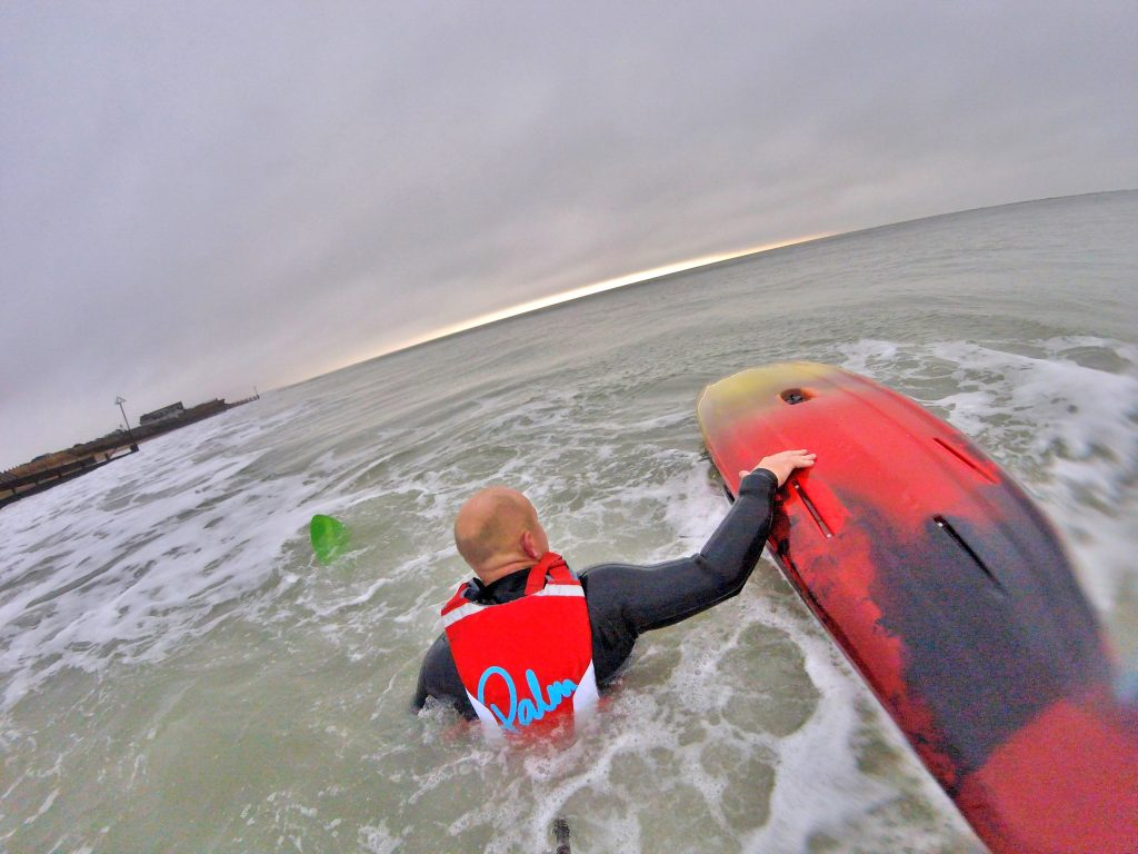 Getting back aboard your sit on top kayak after a wipe-out in waves 3