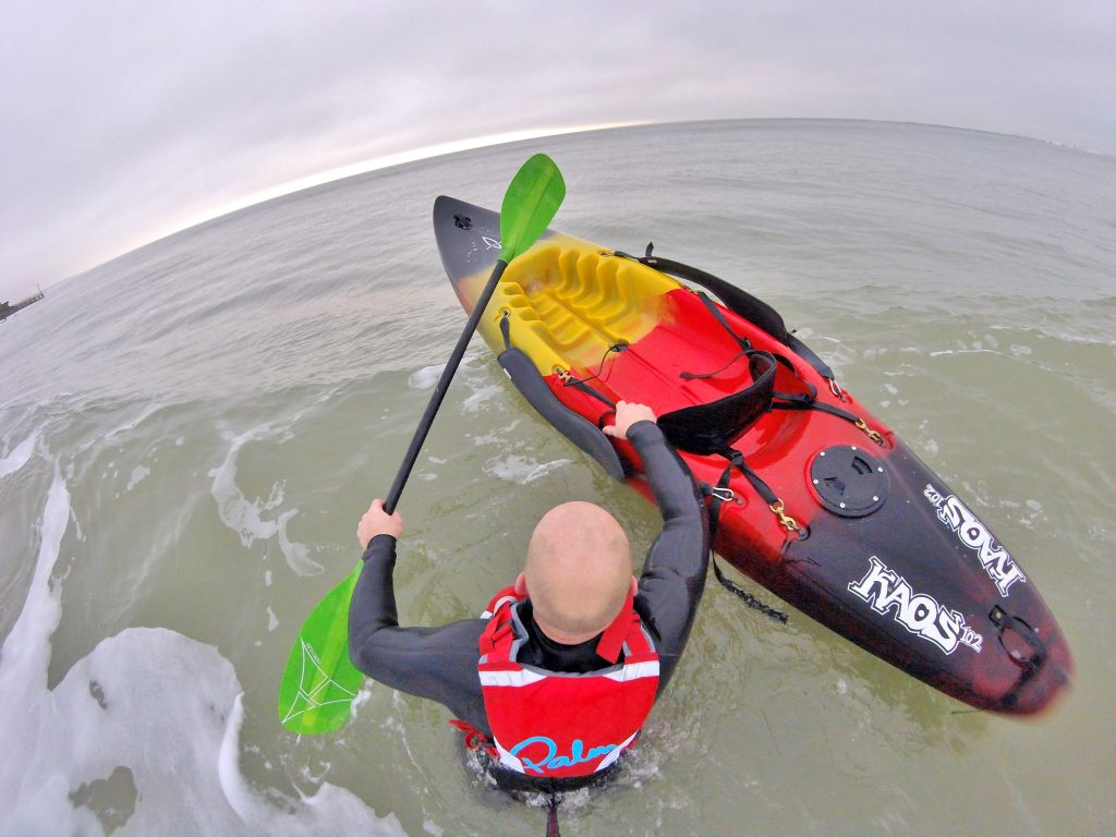 Getting back aboard your sit on top kayak after a wipe-out in waves 4