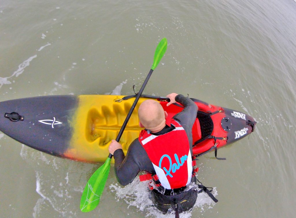 Getting back aboard your sit on top kayak after a wipe-out in waves 5