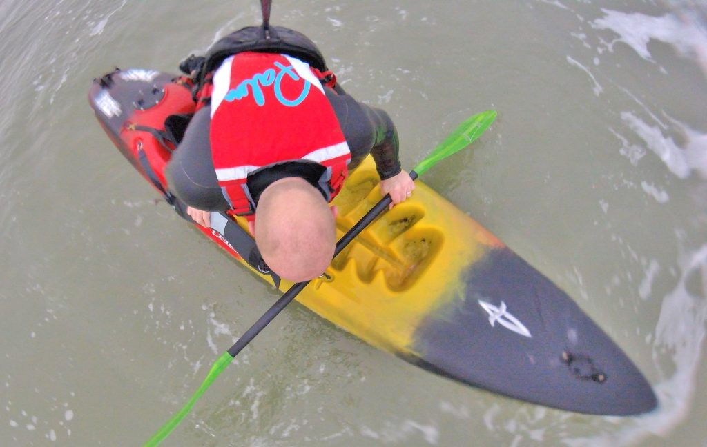 Getting back aboard your sit on top kayak after a wipe-out in waves 7