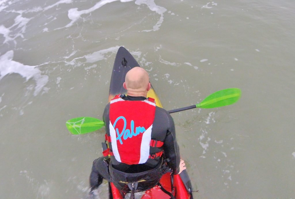 Getting back aboard your sit on top kayak after a wipe-out in waves 8